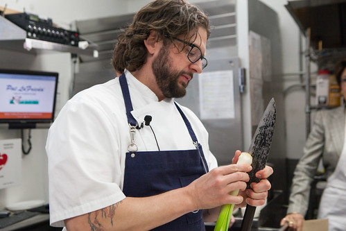 Chef Matthew Lightner of Atera peeling the leeks