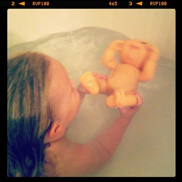 I think she's subjecting baby to swim lessons.... #safestart style