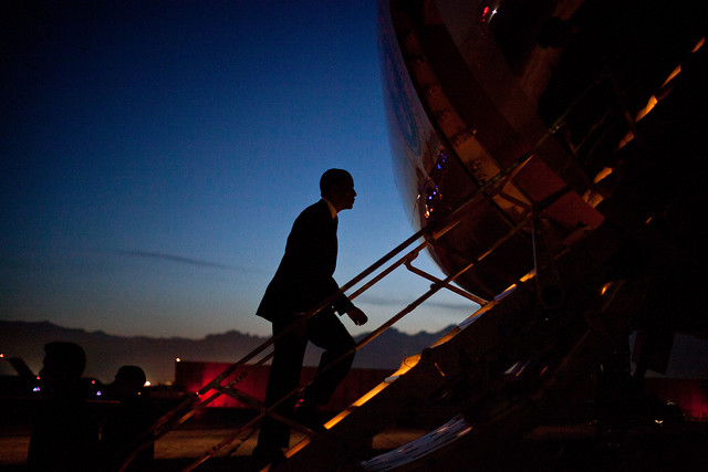 image of President Obama boarding Air Force One at twilight