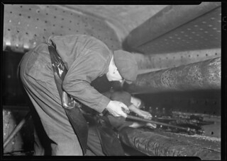 Railroad parts. Baldwin Locomotive Works. Boilermaker tapping for stay-bolts in boiler of a modern locomotive, March 1937