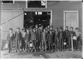 """Boys going home from Monougal Glass Works. A native remark, """"De place is lousey wid kids"""", October 1908"""