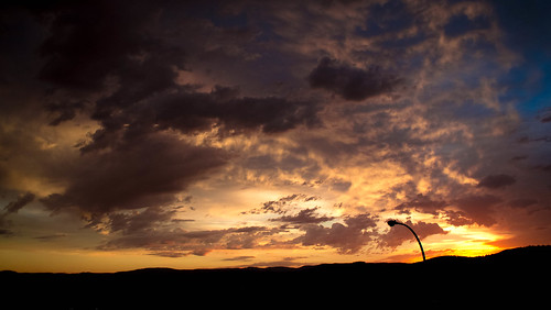 blue sunset sky orange cloud sun storm clouds