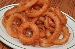 vegetable(0.0), seafood(0.0), produce(0.0), dessert(0.0), churro(0.0), fried food(1.0), side dish(1.0), onion ring(1.0), food(1.0), dish(1.0), cuisine(1.0), snack food(1.0),