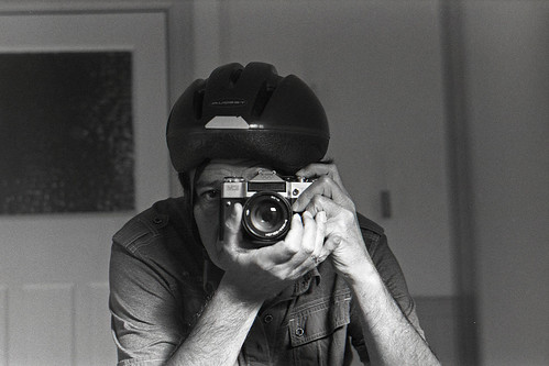 reflected self-portrait with Zenit EM (Moscow Olympics edition) and cycling helmet by pho-Tony