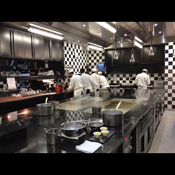 I love the black and white checkered Robuchon kitchen!