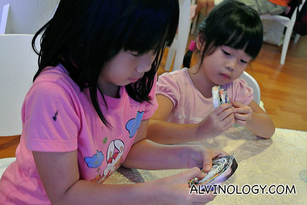 Another two girls with their completed dishes