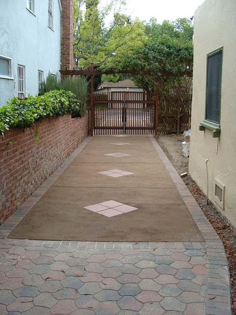 new driveway. Pavers and perveated concrete. Reused ...