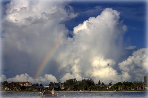 sunrise rainbow storms raining thunderclouds annamariaisland citypier seagullflight