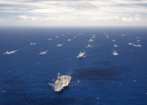 Ships and submarines participating in exercise RIMPAC 2012 sail in formation in the waters around the Hawaiian islands