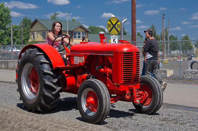1942 Case Tractor : Young woman driving a case tractor draws glance