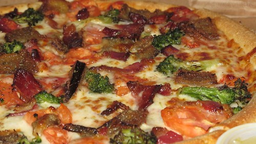 Gourmet veggie pizza with bacon by Coyoty