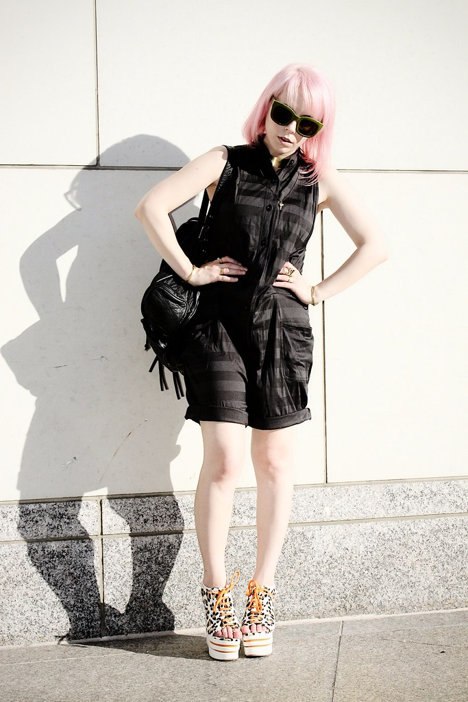 jailhouse chic jumpsuit leather backpack davines pink hair big sunglasses leopard shoes