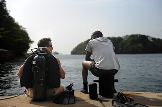 A U.S. Navy diver and a Trinidad and Tobago diver talk during a familiarization dive.