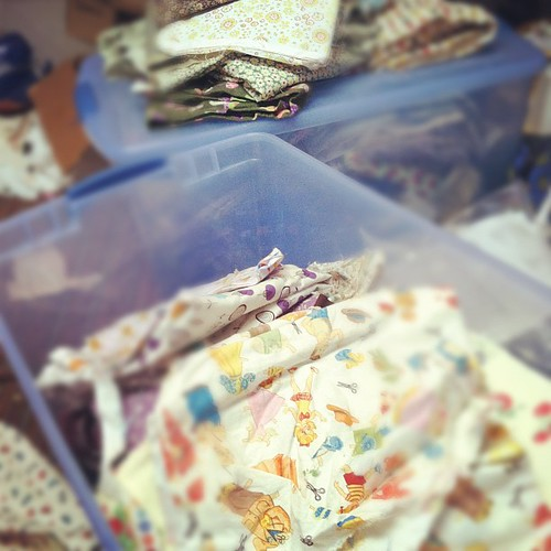 Packing up the fabric. I already have one of these tubs full of fabric to give away, too! I'm very proud of myself.