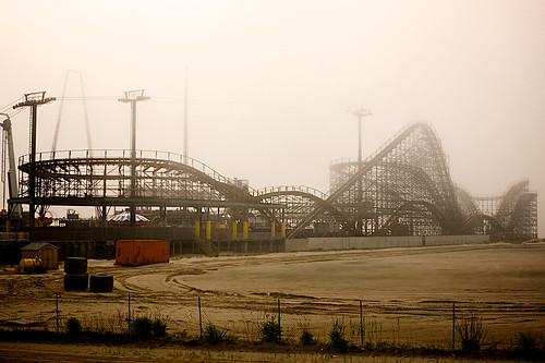Wooden roller coaster covered in fog.