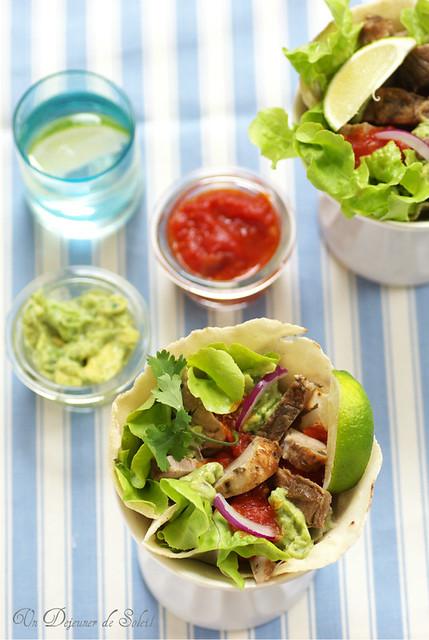 Tacos with pork, salsa roja and guacamole