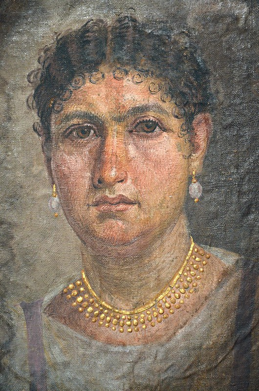 Mummy portrait of Lady Aline, from Hawara, Egypt, painted directly onto the canvas of the mummy wrapping. The Tomb of Aline is an ancient Egyptian grave from the time of Tiberius or Hadrian, excavated at Hawara in 1892, Neues Museum, Berlin
