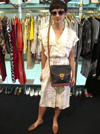 Sut Sut Bo Chio! 1980s stylo mylo dress with with big shoulders - comes with its own belt. Size M. Worn with 1980s leather sandals, a Dooney & Bourke all-weather leather sling bag, and vintage Christian Dior shades.