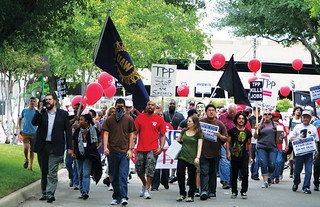 Activists march on the TPP trade talks.