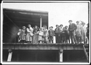 Oyster shuckers and baby tenders at Pass Packing Co. All worked from before daybreak until 5 P.M., February 1911