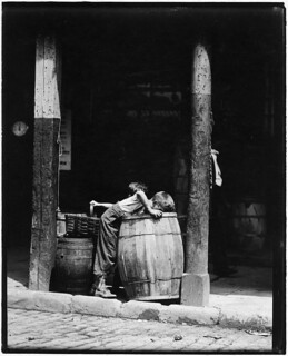 Young boy looking in barrel, 1912