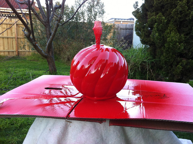 Lamp base spray painted red