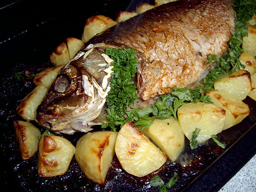 Carp with potatoes and onions