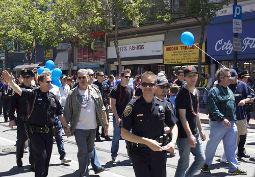 SFPD officers and their loved ones, some walking hand in hand