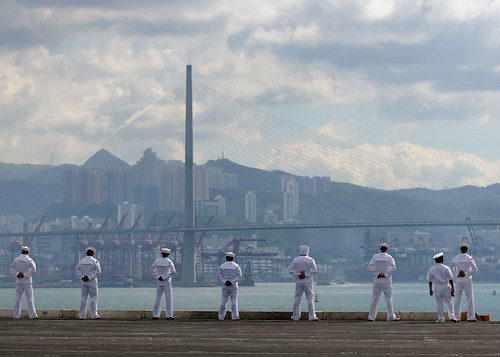 Sailors man the rails of the aircraft carrier USS George Washington while arriving in Hong Kong for a port visit.