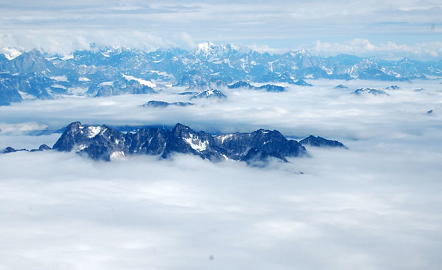 Peaks peeking through clouds - glacier landing alaska