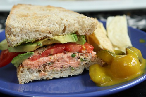 Salmon Salad Sandwich with Avocado, Tomato, Chips, and Mustard Pickles