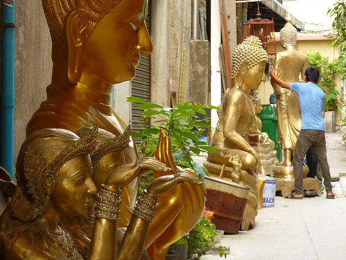 Alley with Buddha statues for renovation