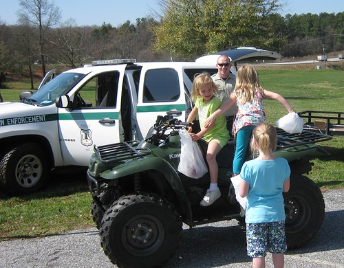 Officer Derik Breedlove gives potential future Forest Service law enforcement officers an opportunity to try out the view from an ATV seat.  Photo credit: USDA Forest Service/Stuart Delugach