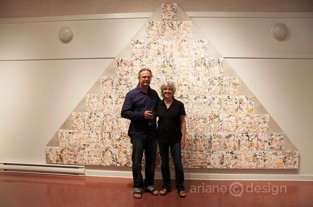 "Deon and Kathy Venter posing with Deon's ""Pyramid Missing #8"""
