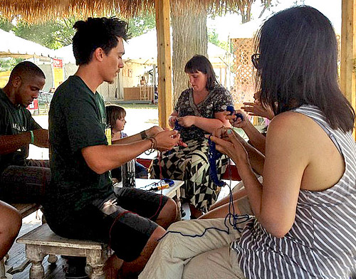 <p>Lei making workshop at the University of Hawaii exhibit at the Smithsonian Folklife Festival.</p>