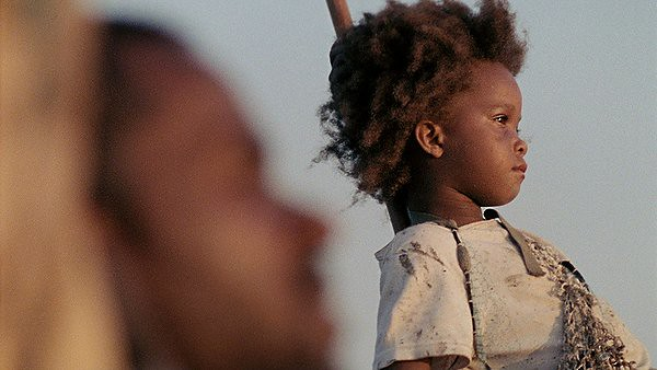 Dwight Henry (blurred, foreground) and Quvenzhané Wallis are BEASTS OF THE SOUTHERN WILD.