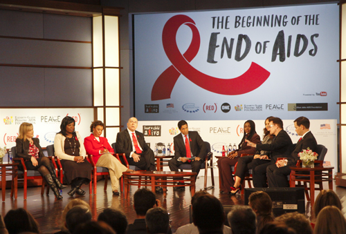 Rep. Barbara Lee, in red, at ONE and (RED)'s World AIDS Day conference in 2011.