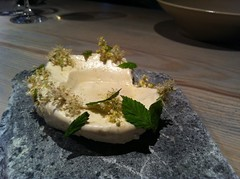 Egg yolk preserved in sugar, crumbs of pine bark, meadowsweet ice cream