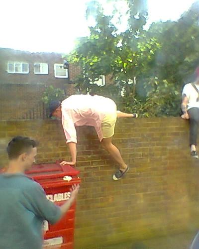 climbing over a wall