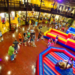 12-038 -- The Titan Carnival at Hansen Student Center featured inflatables, games, carnival food, face painting and live music on the patio.