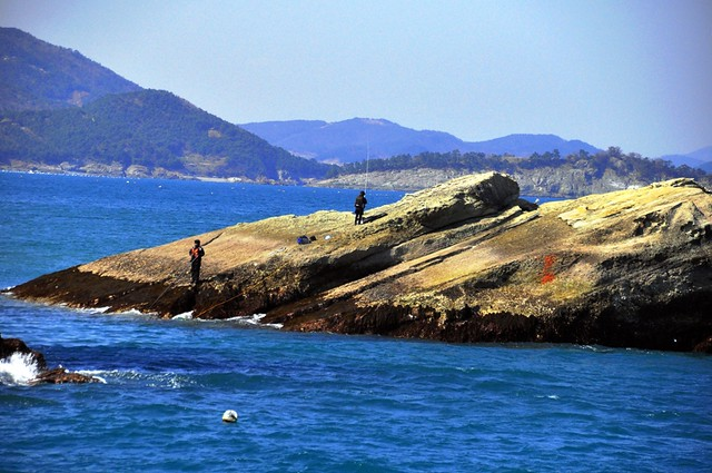Fishing from the rocks off of Sangju Beach, Namhae-do, Korea