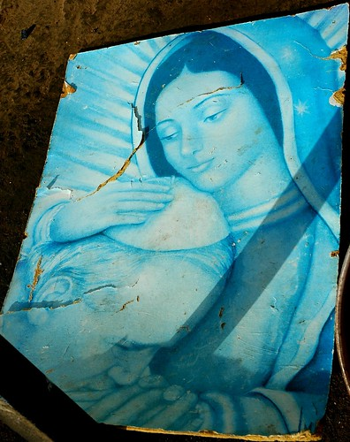 Our Lady of Guadalupe holding Pope John Paul, who prays, universal blue, poster in a folk shrine, northern Mexico by Wonderlane