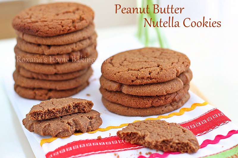 Easy, melt in your mouth peanut butter cookies taken to a whole new level by adding some Nutella to the cookie dough. Recipe from Roxanashomebaking.com