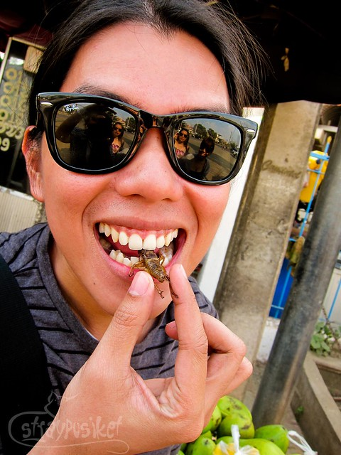 Eating a fried cricket