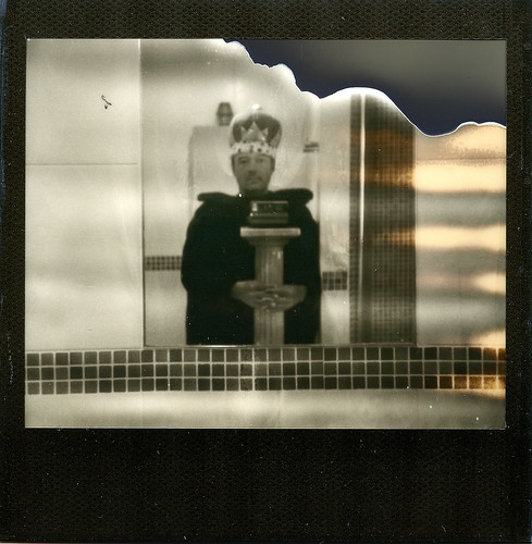 reflected self portrait with Polaroid Image System camera and delusions of grandeur by pho-Tony