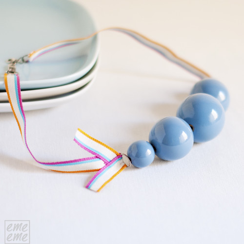 Necklace light blue wooden beads and striped ribbon