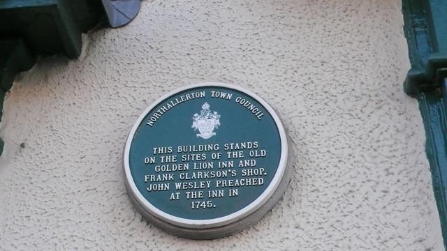 Photo of John Wesley green plaque