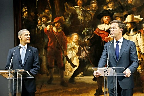 Barack Obama stands in front of Rembrandt's The Night Watch in the Netherlands