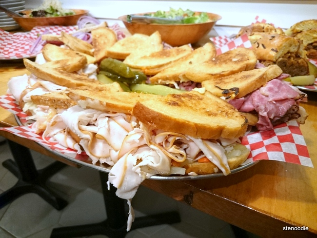platter of turkey and smoked meat sandwiches
