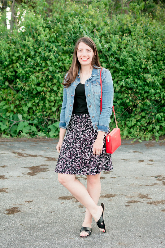 denim jacket + loft palm print skirt + black tee + red purse; casual summer outfit | Style On Target